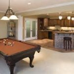 delightful basement finishing visualized with contemporary home bar and charming billiard pool