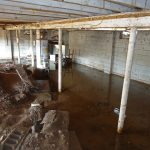 dirty flooding basement damage room