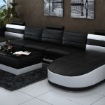 double chaise sectional sofa in black and white thick black fury carpet white ceramic floors modern minimalist standing lamp