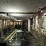 eccentric conference room designs with rustic stone wall and concrete ceiling mixed finest black swivel chairs and overly long glass table