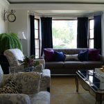 edyta chicago interior design firms of living room with brown sofa and armchair plus coffee table with rug floor area
