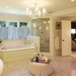 enchanting chandelier overlooking with fancy corner shower adnd wooden alcove tub in amazing budget bathroom remodel