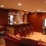 enthralling red wall paint color for festive basement finishing ideas with remarkable home bar and theatre room