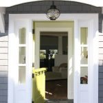 entrance door in Dutch door style with sidelight feature in left and right of door