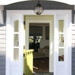 entrance door in Dutch door style with sidelight feature in left and right of door