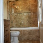 Exotic Brown Tile Bathroom Design With Cool Shower Head And Luxurious Bathtub In Modern Style Aside White Toilet Seat With Wooden Vanity Beneath White Ceiling With Small Lamps