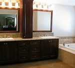 finest bathroom remodel on budget combined with cool black vanity sets with white sink under nice sconces and framed mirror on brown laminate floor aside platform bathtub