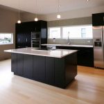 Flashing White Counertop Of Black Kitchen Cabinetry Idea Above Laminated Bamboo Flooring Style Aside Modern Storage And Amazing Bright Glass Windows