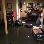 flooding basement in mess room with table and chairs