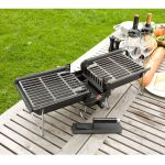 folding Hibachi grill in mini size a pair of wine glasses two bottles of wine a large sausage