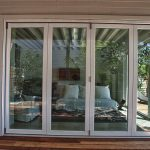 four series la cantina glass door with white trims as front door