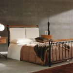 free standing headboard in white brown warm bed cover unique and stylish bedside table with beautiful table lamp warm brown fury carpet