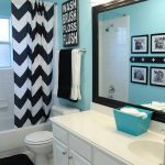 fresh blue cute bathroom ideas with bathtub covered with curtain and toilet and white vanity units plus mirror and sink and tile floor and wall scones
