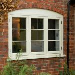 great cottage style windows in casement style with white solid wood material plus clear glazing and brick wall