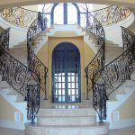 highclass and luxurious staircases with black metal railing as the decorative feature and safety system