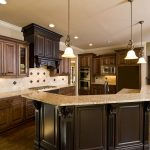 impressive kitchen remodeling with marble countertop on dark cabinets curved  island combined with wooden floor and pendant lamps and backsplashes