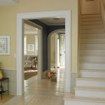 interior exterior painting with natural paint color scheme plus wooden floor and end tables with art displays and stairs
