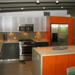 kitchen cabinet in mid century style with metal handles metal-finishing kitchen appliances