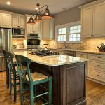 kitchen remodeling northern va with white wooden cabinets and marble countertop and stove plus sink combined with natural back splashes and beautiful pendant lighting and wood laminate floor
