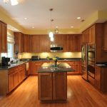 kitchen remodeling northern va with wooden cabinets plus marble countertop and kitchen island plus pendant lights and sink combined with cool kitchen appliances and wood laminate floor
