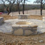 large rounded fire pit for permanent seating in outdoor patio