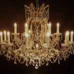 luxurious and classy pendant chandelier unit with artificial candles and crystal