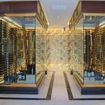 luxurious double modern wine cellar idea with glass walk in cellar with gorgeous lighting and stunning wine racks in spacious room with black line accent on white floor