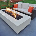 luxurious in ground fire pit design upon gray concrete idea before black seating with white bolster and orange cushions