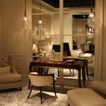luxurious interior design in cream nuance with modern area rug with cream leather bench and sofa and pendants and wooden vanity