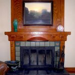 luxurious traditional fireplace with craftsman wood frame  a painting framed by black wood frame