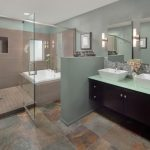 master bath remodel with glass walk in shower and bath tub plus modern vanity units with granites and double sinks and large mirrors plus natural tiles