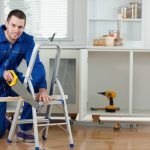 men remodel contractor for home interior with saw and other repair tools
