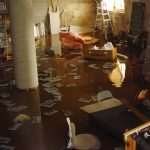 Mess Flooding Basement With Stairs And Chairs
