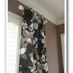 metal half rod with neutral colored patterns curtain