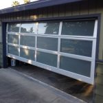 mid century modern garage doors with glass and wood wall for two cars
