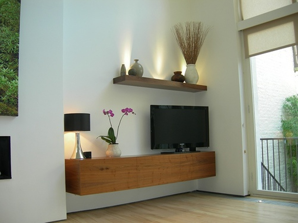 Minimalist Floating Wood Media Console With Tv Set A Porcelain Vase For Beautiful Flowers Table