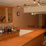 modern basement wet bar design ideas uwith l shaped track lighting and mid century bar stools  also glass door cupboard