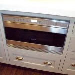 modern microwave drawer that is built in kitchen cabinet system