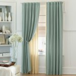 modern minimalist green silky curtain idea for small window with sheer yellow curtain on white wall aside wall unit with crysantium flwer and white table