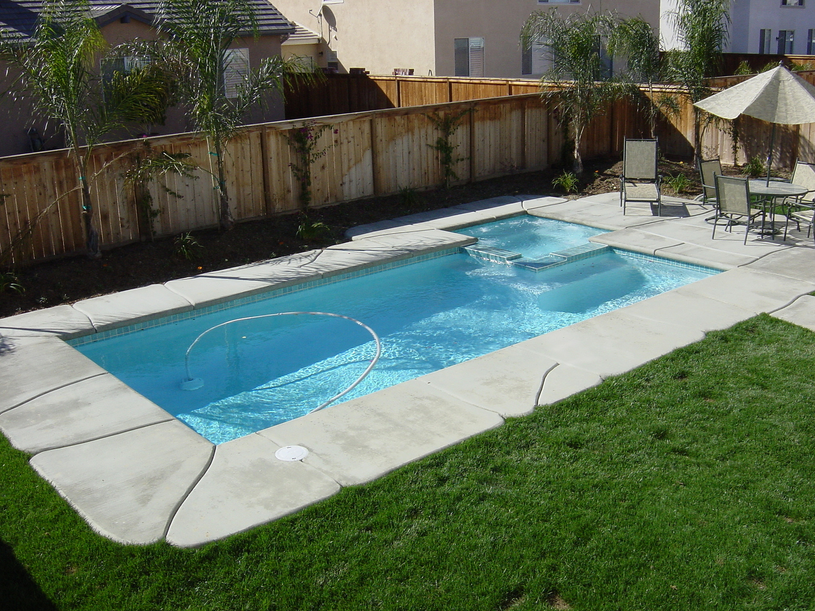 Modern Rectangle Pool Designs With Cool Natural Stones Edges And Outdoor Chair Together Umbrella At