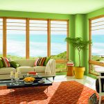 most energy efficient windows with amazing view plus clear glazing casement and awning windows in living room with modern sofa and black coffee table with rug underneath