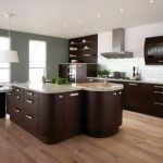 Natural Beige Bamboo Flooring In Kitchen With Brown Modern Cabinet Design With Stainless Steel Handles And White Chairs And Modern Smokestack And Brick Backsplash With Tall Glass Windows