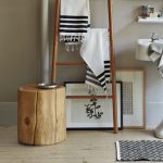 natural stained wood stump table in bathroom a traditional vanity with sink and faucet a leaning wood rack for drying clothes