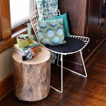 Natural Tree Stump Side Table White Lightweight Metal Chair With Blue Pillow And Dark Blue Seating Feature Solid Wood Floors A Pile Of Books Two Small Decorative  Pots
