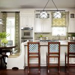 Pretty Banquette Seating Ideas With White Bench And Round Wooden Table With Beautiful Flowers Plus Kitchen Island With Cute Chairs And Curtain Plus Pendant Lighting