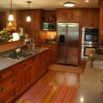 pretty kitchen remodeling northern va with wood cabiner with steel countertops with sink and stoves plus romantic pendant lamps and steel kitchen appliances and wood laminating floor