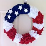 red blue white rosette wreath with white painted stars  for fourth of july celebration