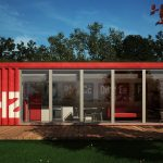 red-container home with large glass doors and glass windows in white frames a set of metal furniture for patio