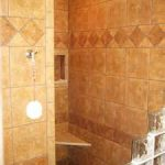 shabby chic walk in shower design ideas feats with light brown tile backsplash and floor and glass block panel and corner bench