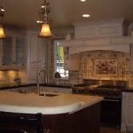 shady light  fixtures in calming kitchen remodeling orange county with cool two tones countertop and chic backsplash design